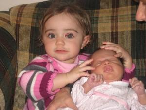 Cousin Olivia holding Raegan